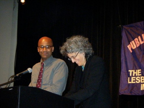 Last year's winner, Kai Wright and Andrea Weiss, share a laugh on stage before naming the winners of the nonfiction awards.